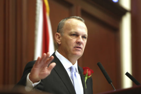 Scott Takes Aim at Corcoran Over Legal Work