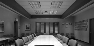 A modern boardroom or meting room in black and white with 12 chairs hedge fund