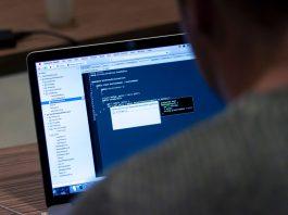 Man facing a computer
