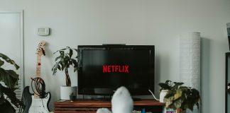 A man watching Netflix on TV.